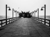Pier With Lamps In Black And White