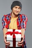 picture of beanie hat  - Stylish young man in shirt and beanie hat with gift box - JPG