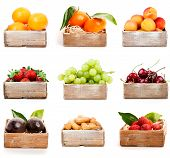 stock photo of apricot  - Set of orange tangerine apricot strawberry grape cherry nuts in the wood box - JPG