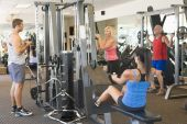 image of training gym  - Group Of People Weight Training At Gym - JPG