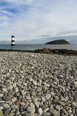 Penmon Beach, Anglesey, Wales. Lighthouse And Puffin Island.
