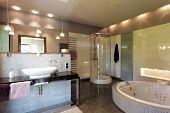 pic of bathing  - A big luxurious bathing room with elegant lighting - JPG