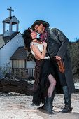 image of crossed pistols  - Old West Man and Woman About to Kiss - JPG