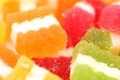 Background of different fruit-paste candies.