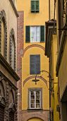 Backstreet with typical italian houses in Lucca, Tuscany