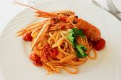 Pasta with tomato sauce and langoustines, close-up