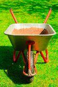 Gardening. Garden Wheelbarrow With Sand Soil.
