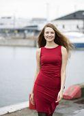 Happy Young Woman At Dress At Wharf