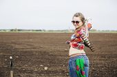 Woman With Rake And Part Of Shovel