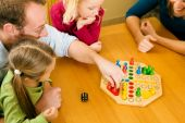 Family playing board game