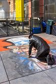 Street Artist Draws On Asphalt Uncle Sam In Paris