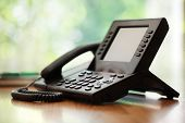 image of liquids  - Business telephone with liquid crystal display on a desk in an office - JPG