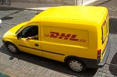 LISBON, PORTUGAL - MAY 29, 2014: A DHL delivery van on the street in the city center Lisbon. DHL is