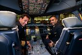 HONG KONG, CHINA - MAY 16, 2014: pilots in Emirates Airbus A380 aircraft after landing MAY 16, 2014.