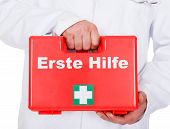 Male Doctor Carrying A Portable First Aid Kit