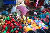 HIKKADUWA, SRI LANKA - FEBRUARY 23, 2014: Local street vendor selling plastic products. The Sunday m