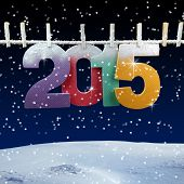 foto of clotheslines  - Number 2015 hanging on a clothesline in a night wintry background - JPG