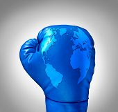 picture of competing  - Global competition and competing globally as a business concept with a blue leather boxing glove with a map of the world incorporated in the texture as a symbol and metaphor for fighting international challenges - JPG