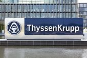 Essen, Germany - September 1, 2011: ThyssenKrupp logo in front of the new headquarter building. Thys