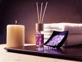 Spa Massage Border Background With Towel Stacked, Perfume Diffuser And Sea Salt