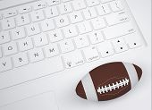 American football ball on the keyboard