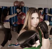 Boxing aerobox blond woman portrait in fitness gym training workout