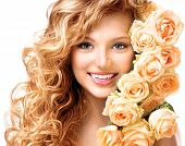 picture of perm  - Beauty model girl with long curly red hair and beautiful red roses hairstyle - JPG