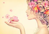 stock photo of perm  - Beauty girl takes beautiful flowers in her hands - JPG