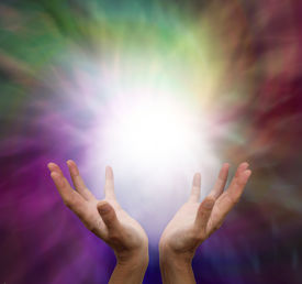 pic of magi  - Healer with hands outstretched sensing energy on muted color background - JPG