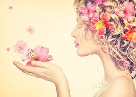 foto of perm  - Beauty girl takes beautiful flowers in her hands - JPG