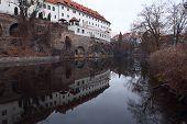 foto of bohemia  - Old Jesuit dormitory in Cesky Krumlov reflected in Vltava river - JPG