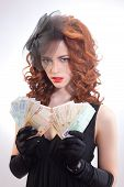 Young woman holding euro money