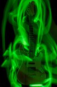 A hell's guitar surrounded by green flames