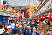 TOKYO, JAPAN - OCTOBER 27,2014:  Nakamise shopping street in Asakusa, Tokyo. The busy arcade connects Senso-ji Temple to it's outer gate Kaminarimon, which can just be seen in the distance.