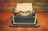 old typewriter on wooden table, retro filtered, instagram style