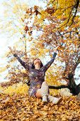 Beautiful Women Throwing Leaves In The Air
