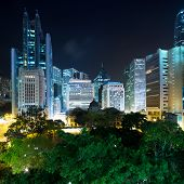 night cityscape and green park of modern city