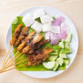 Skewered and grilled meat , chicken sate or satay, served with peanut sauce. Fresh cooked with steamed and smoke. Delicious hot and spicy Asian dish.
