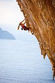 Family rock climber at sunset.