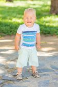 Baby walking in the park