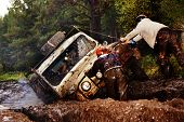 SUV Overcomes Mud Obstacles
