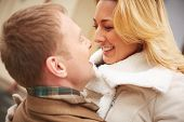 stock photo of sweethearts  - Happy blond female in embrace of her sweetheart - JPG