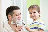 child boy attempting to shave like his dad