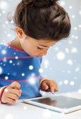 education, winter, technology and people concept - little girl with tablet pc at home