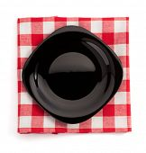 plate at cloth napkin on white background