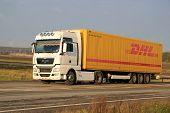 White Man TGX 18.480 Truck Hauls Dhl Trailer