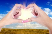 Woman Hands In The Form Of Little Heart Over A Blue Sky