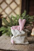 Christmas handmade heart shaped decoration in linen bag