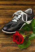 Black Man's Shoe And Rose
