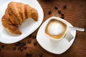Top View Of Cappuccino Coffee With Croissant.